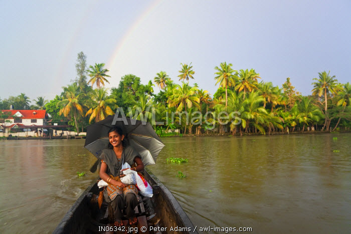 awl-images.com - India / Canoe ferrying passengers across river, Kerala Backwaters, Alappuzha or Alleppey, Kerala, India