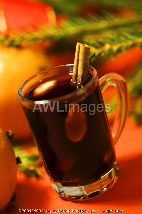 A glass of wine with cinnamon