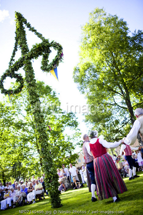 People celebrating midsummer in a traditional festival, Sweden.