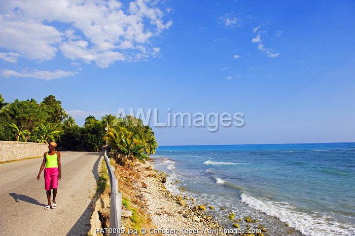 The Caribbean, Haiti, Port of Prince, Jacmel, women walking near a beach,