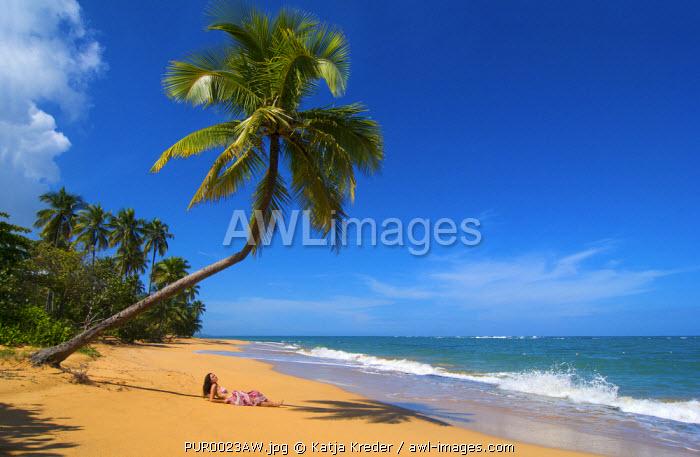 Woman relaxing on beach, Palmas de Mar, Puerto Rico (MR)