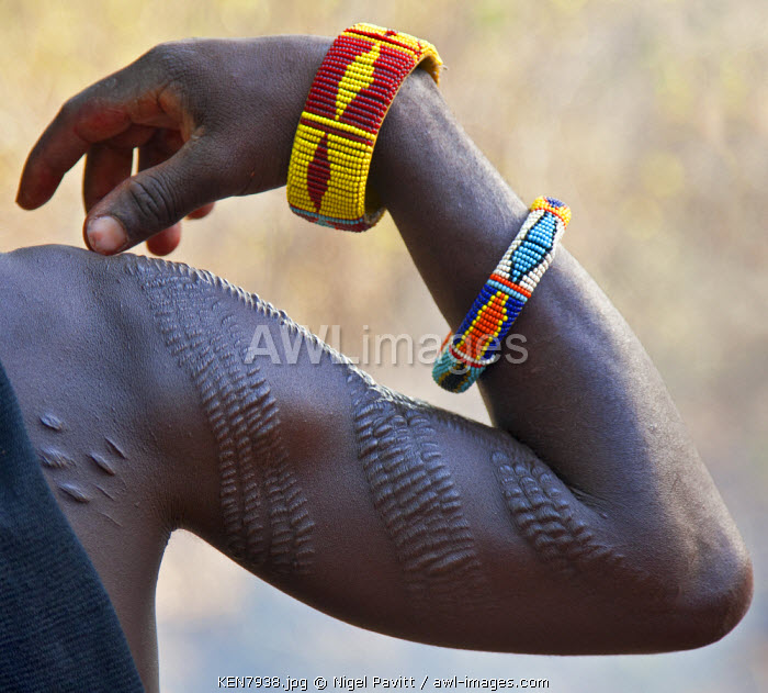 A Pokot man with scarification on his right arm.  This form of body art is quite common among his tribe. The cicatrices are raised by rubbing charcoal or the sap of a plant into them when the wounds are still fresh.