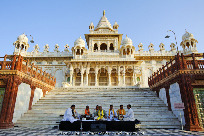 India, Rajasthan, Jodhpur. Musicians at the Rajasthan International Folk Festival, perform in front of the Jaswant Thada, a memorial to Maharaja Jaswant Singh II.