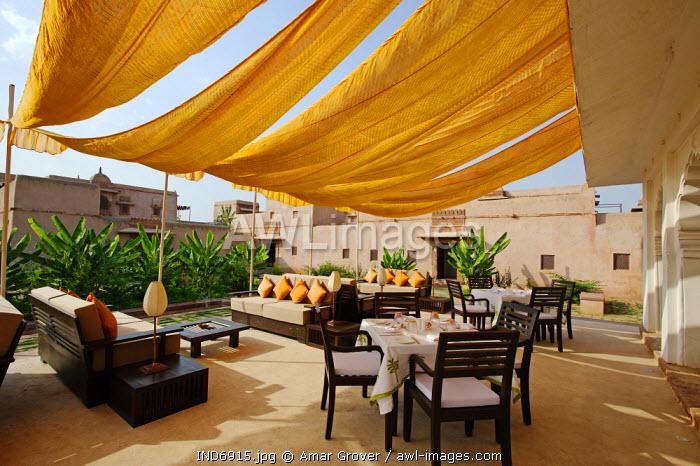 India, Rajasthan, Nagaur. The informal al fresco dining terrace of Ranvas, a luxury hotel occupying part of Ahichhatragarh Fort.
