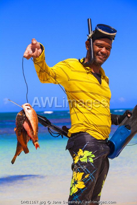 Dominican Republic, Samana Peninsula,  Las Terrenas, Spear fishermen on Las Terrenas beach