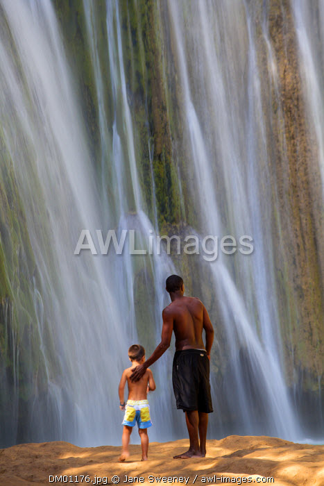 Dominican Republic, Eastern Peninsula De Samana, Man and child looking at El Limon Waterfall