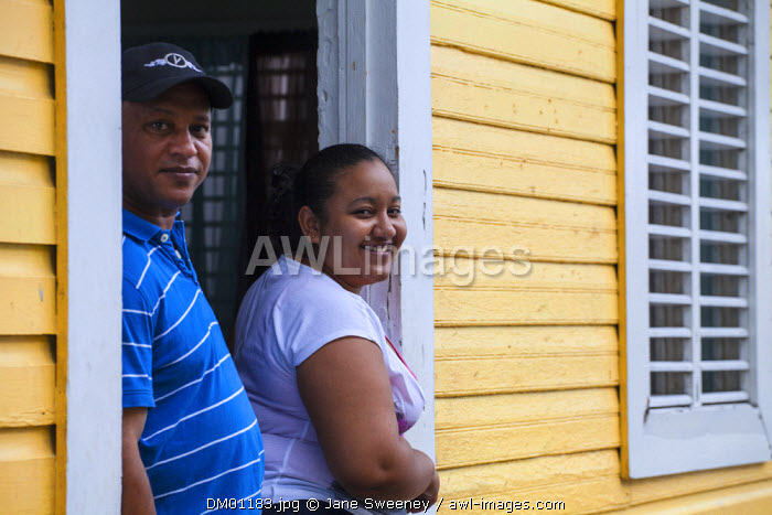 Dominican Republic, Puerto Plata, Couple in doorway of their house