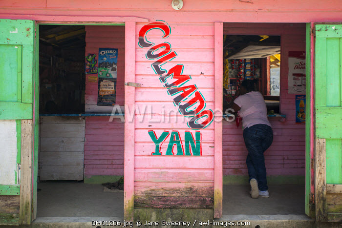 Dominican Republic, Rio San Juan, Lady in old wooden shop