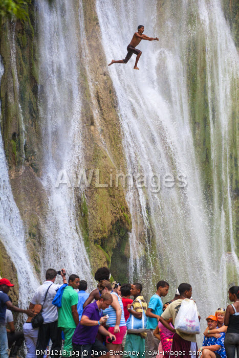 Dominican Republic, Eastern Peninsula De Samana, Man jumping from rocks at El Limon Waterfall