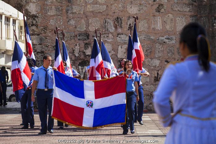 Dominican Republic, Santa Domingo, Colonial zone, Park Independencia, College students with National flag at Altar de la Patria