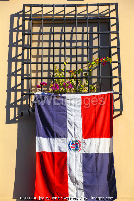 Dominican Republic, Santa Domingo, Colonial zone, Dominican flag hanging from window of Colonian house