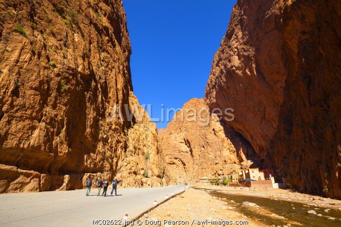 Restaurants & hotels sit underneath overhanging cliffs in the dramatic Todra Gorge, Todra Gorge, Morocco