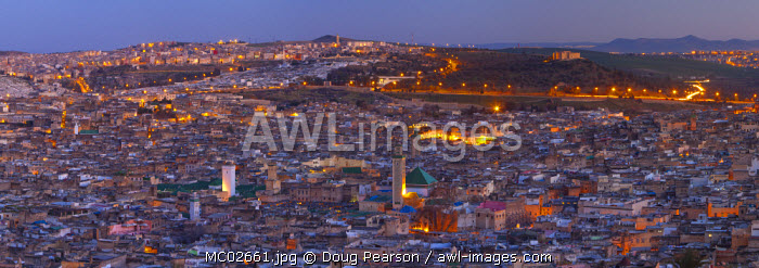 Elevated view across the Old Medina of Fes illuminated at Dusk, Fes, Morocco