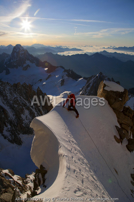awl-images.com - France / Chamonix, Haute Savoie, France: Lone Alpinist On The Higher Reaches Of The Kuffner Arete In The Morning, On Mont Maudit. Chamonix, France
