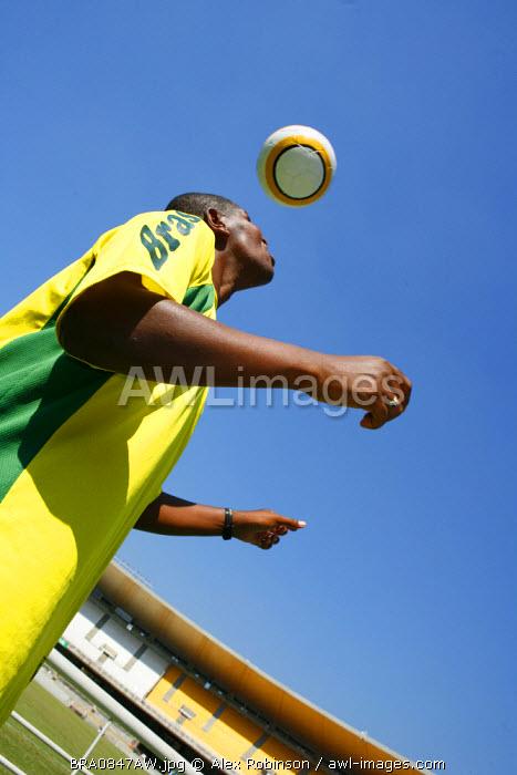 South America, Rio de Janeiro, Rio de Janeiro city, Brazilian football player showing skills on a tour of the Maracana football stadium