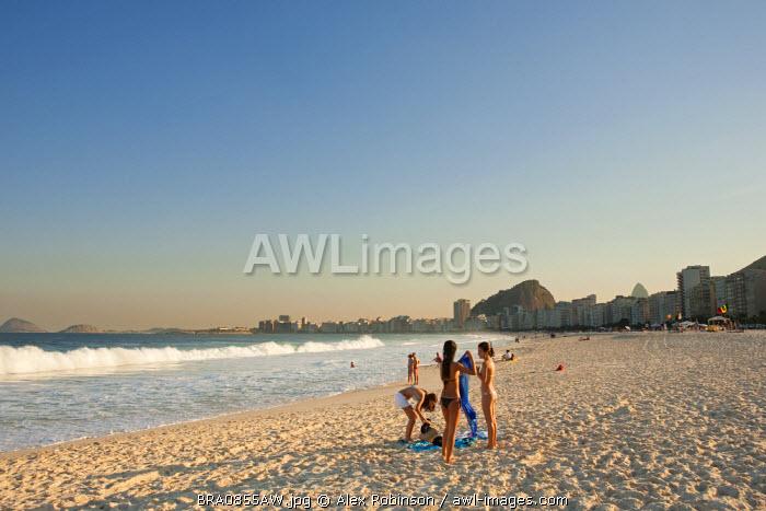 South America, Rio de Janeiro, Rio de Janeiro city, girls in bikinis on Copacabana Beach