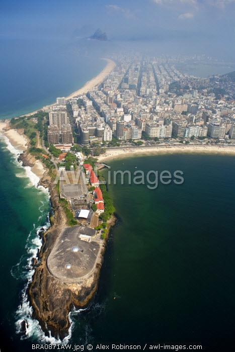 South America, Brazil, Rio de Janeiro State, Rio de Janeiro city, The Arpoador showing Copacabana Fort (Forte do Copacabana). Arpoador beach lies to the north west of the picture, Copacabana to the South