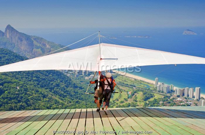 Brazil, Rio de Janeiro state; Rio de Janeiro city; Hang gliding from the Pedra Bonita in Tijuca National Park (Parque Nacional da Tijuca)