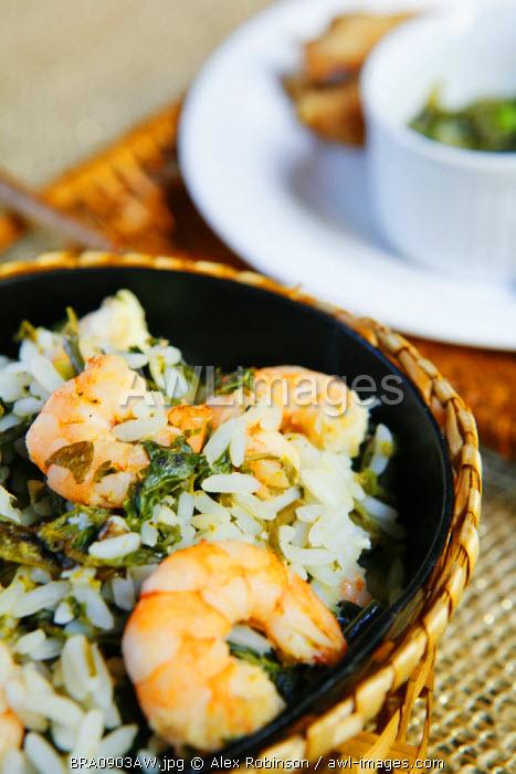 South America, Rio de Janeiro, Rio de Janeiro city, Prawns risotto with greens in the Espirito Santa restaurant in Santa Teresa
