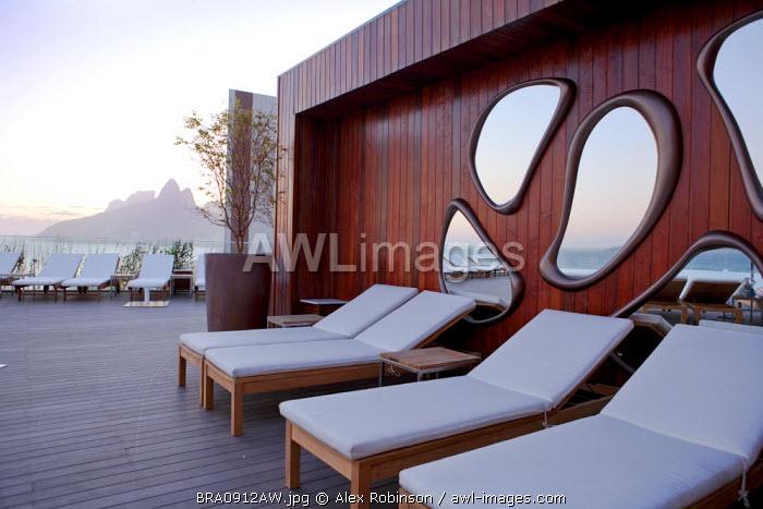 South America, Rio de Janeiro, Rio de Janeiro city, Ipanema, rooftop swimming pool deck of the Fasano hotel with the Dois Irmaos mountains behind