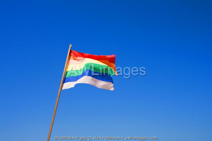 South America, Rio de Janeiro, Rio de Janeiro city, Ipanema, Rainbow flag on Ipanema beach at the end of Farme de Amoedo Street