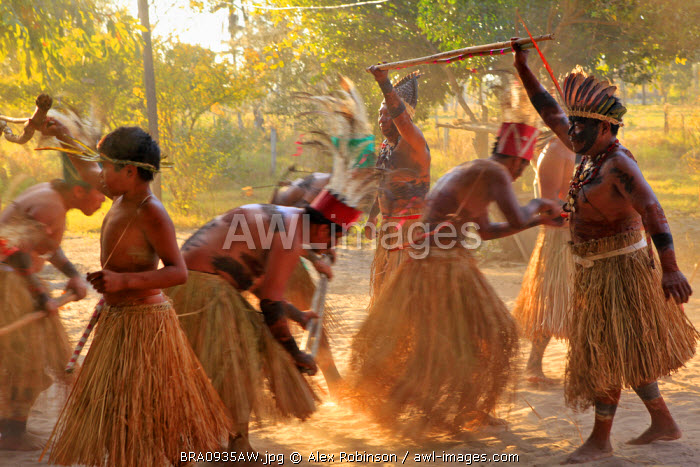 South America, Brazil, Miranda, Terena indigenous people from the Brazilian Pantanal performing a ritual stick dance in grass skirts