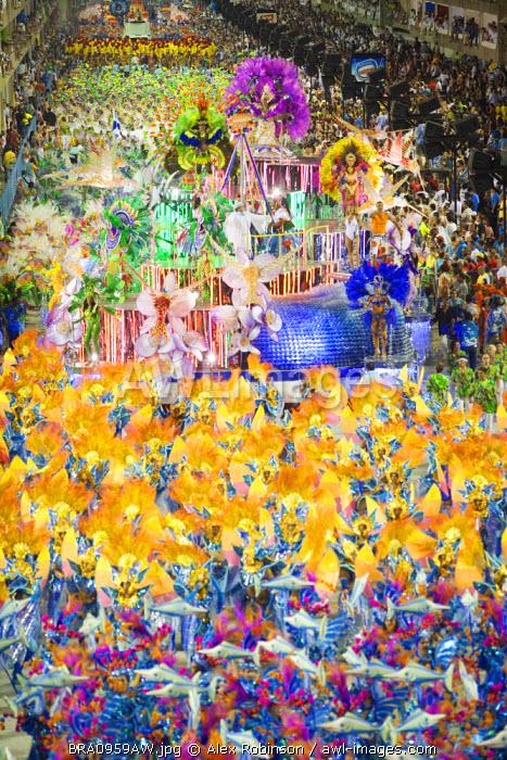 South America, Rio de Janeiro, Rio de Janeiro city, costumed dancers at carnival in the Sambadrome Marques de Sapucai