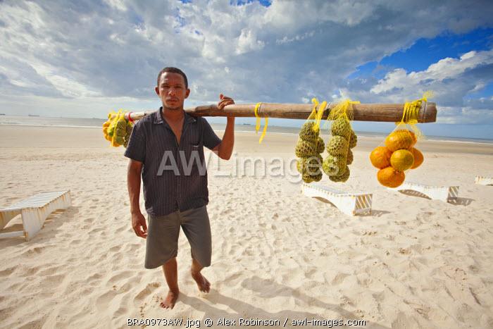 South America, Brazil, Maranhao, Sao Luis, Sao Marcos beach, fruit vendor selling custard apples and oranges