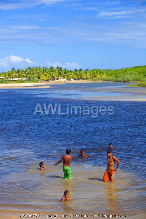 South America, Brazil, Bahia, Ponta do Corumbau, Parque Nacional do Monte Pascoa, indigenous Pataxo children from the Aldeia Xand� community swimming in the Corumbau river