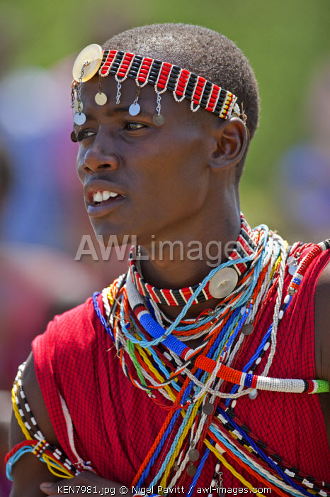 A Maasai schoolboy in traditional attire sings during an inter-schools song and dance competition, Kenya