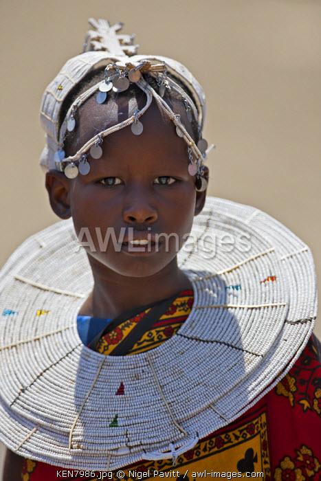 A young Maasai girl at Magadi. Her white beaded ornaments denote that she is a Kisongo Maasai, Kenya