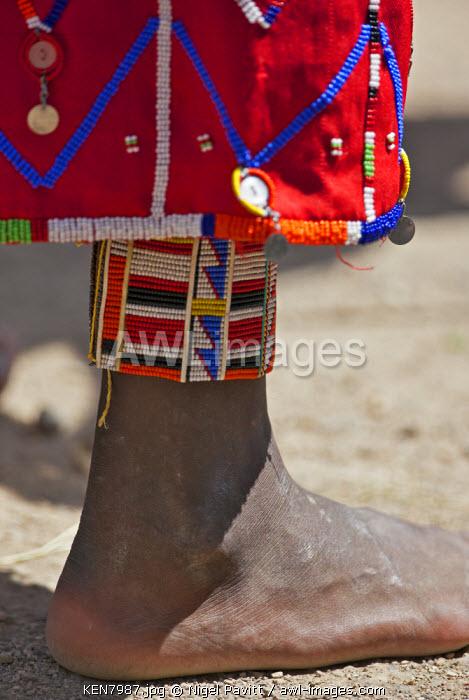 The colourful beaded anklets and decorated skirt of a Maasai woman at Magadi, Kenya