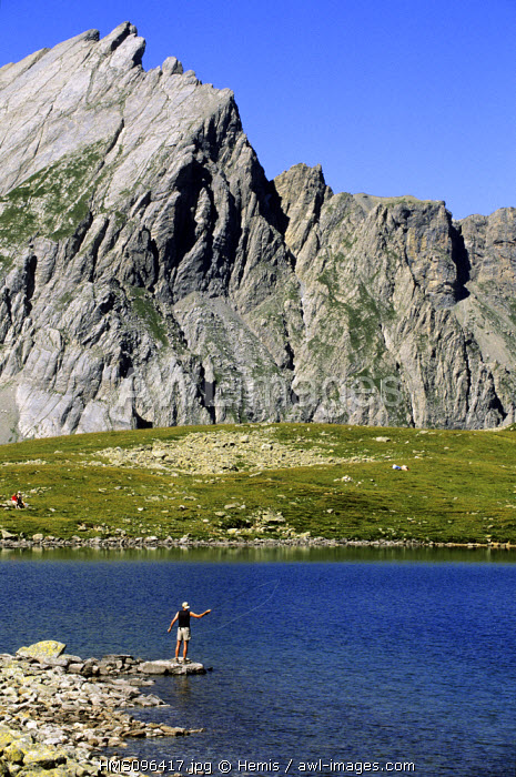 France, Haute Savoie, Tour du Mont Blanc (TMB), fisherman at the lake Jovet (2175 m)