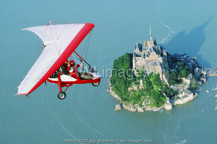France, Manche, Mont-Saint-Michel (aerial view) of an ULTRALIGHT FLYING ABOVE the MOUNT
