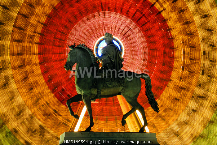 France, Rhone, Lyon, historical site listed as World Heritage by UNESCO, the equestrian statue of Louis XIV on Place Bellecour (Bellecour square) in front of the great wheel