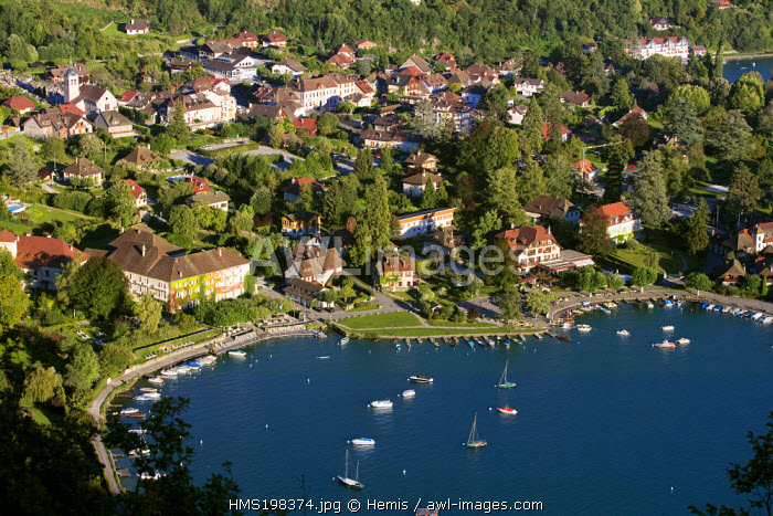 France, Haute avoie, Talloires on the banks of Annecy lake and Hotel of the abbey (property of actor Jean Reno) on the right down (aerial view)