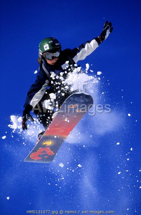France, Savoie, snowboarder in the powder snow of Meribel skiing area