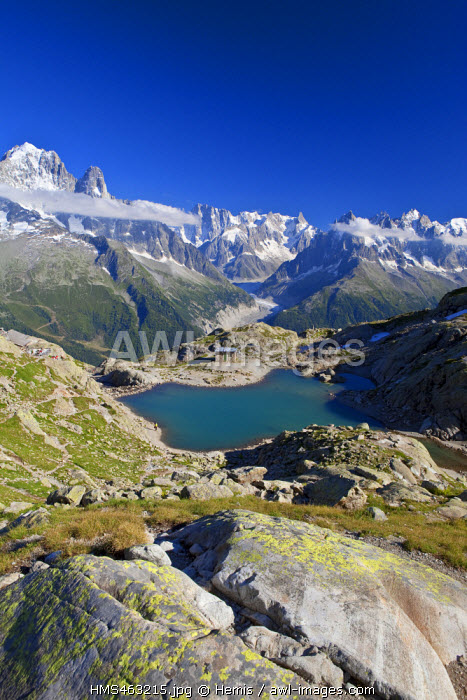 France, Haute Savoie, Chamonix Mont Blanc, former refuge and lac Blanc (2352m) in the Reserve naturelle nationale des Aiguilles Rouges (Aiguilles Rouges National Nature Reserve) with a view on the Mer de Glace and the Aiguille Verte(4122m) on the left