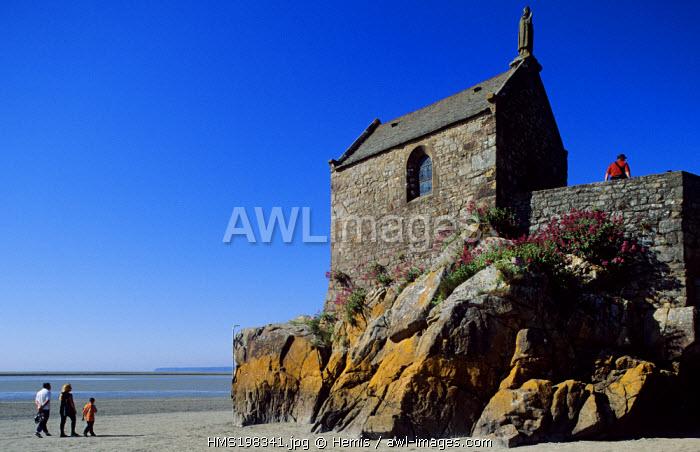France, Manche, Mont Saint Michel listed as World Heritage by UNESCO, Saint Aubert Chapel, tourists walking on the beach