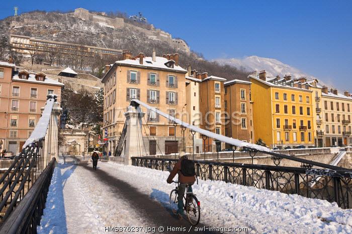 France, Isere, Grenoble, the Saint Laurent Bridge over the Isere River with the Saint Laurent District in the bakcground