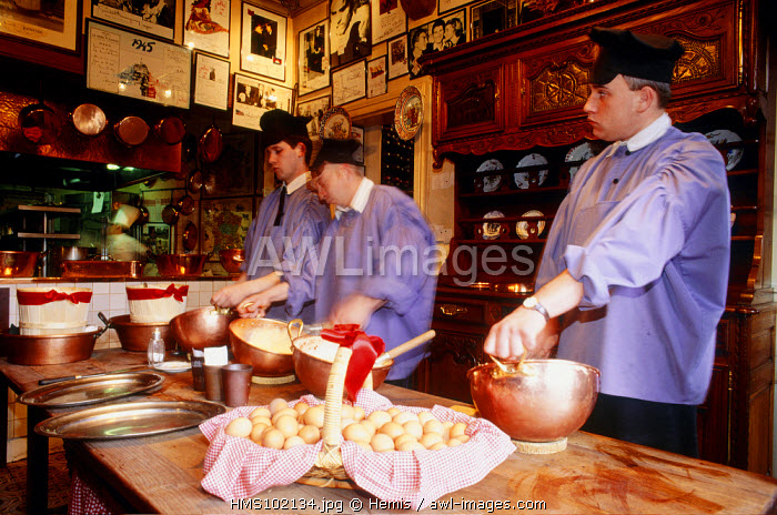 France, Manche, Mont Saint Michel, the restaurant de La Mere Poulard, where the most famous omelette in the world is prepared in front of customers and served by waiters wearing the traditional Norman costumes