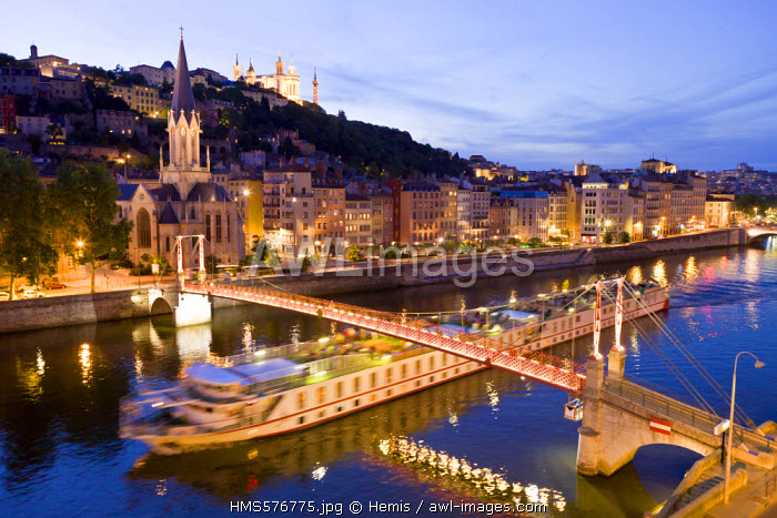 France, Rhone, Lyon, historical site listed as World Heritage by UNESCO, footbridge and St Georges Church over Saone River and Notre Dame de Fourviere Basilica, tourist barge with restaurant