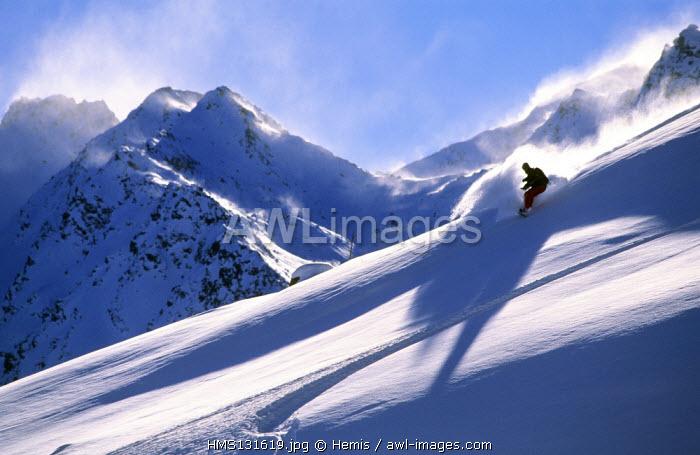 France, Savoie, Trois Vallees ski area, Meribel, surfer