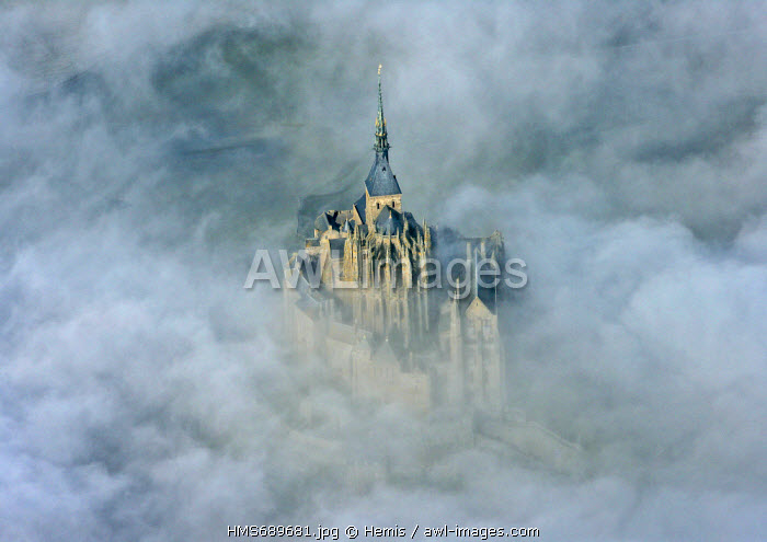 France, Manche, Bay of Mont Saint Michel, listed as World Heritage by UNESCO, Mont Saint Michel apeared from mists (aerial view)