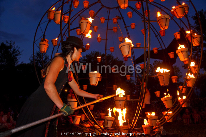 France, Isere, Grenoble, Parc Paul Mistral, Festival Cabaret Frappe, launching summer festivities by the Compagnie Carabosse who enlights the park with 6000 fire pots
