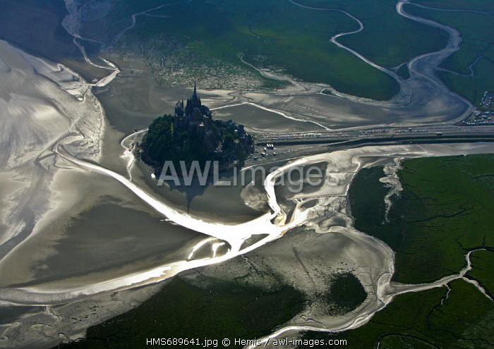 France, Manche, Bay of Mont Saint Michel, listed as World Heritage by UNESCO, back light on Mont Saint Michel (aerial view)