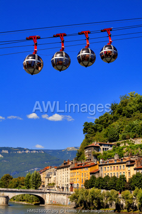 France, Isere, Grenoble, Isere river bank with the Saint Laurent District and the most ancient urban cable car in the world with the Marius Gontard Bridge in the background