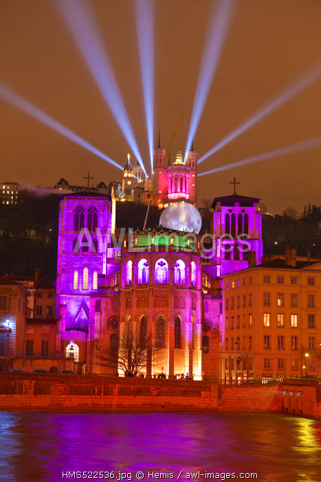 France, Rhone, Lyon, historical site listed as World Heritage by UNESCO, St Jean Cathedral at the edge of Saone River and Notre Dame de Fourviere Basilica during the Fete des Lumieres (Light Festival)