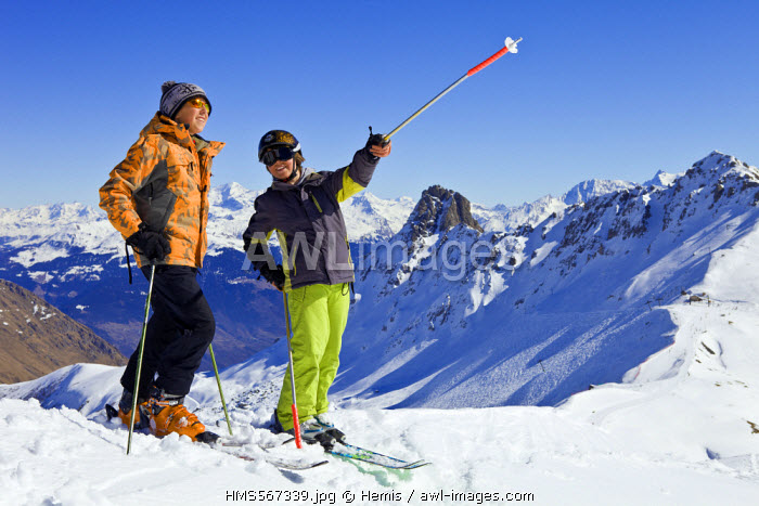 France, Savoie, Massif de La Vanoise, La Tarentaise Valley, Valmorel, teenager in the winter sports above the Col du Riondet with a view of the Pointe du Grand Nielard (2544m)