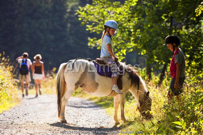 France, Savoie, Valmorel, pony ride at Plan Parc (1430 m)
